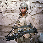 """Location:<br /> Patrol Base Fires, Sangin District, Helmand Province, Afghanistan<br /> <br /> Unit: <br /> 3rd Squad, 1st Platoon, Bravo Company, 1st Battalion, 5th Marines<br /> <br /> Name and Rank: Corporal Manuel """"Dozer"""" Mendoza<br /> <br /> Age: 20<br /> <br /> Hometown: Weslaco, Texas<br /> <br /> Why did you join the Marine Corps?<br /> <br /> """"I joined the Marine Corps because I'll never forget September 11th . . .  I love my country, I'm a patriot straight up, even though I'm Mexican. I feel like I got a debt to the United States because I have such a great life back at home. I have my family, I had a good education, you know? So I felt like I gotta pay that debt.""""<br /> <br /> <br /> What did you expect from Afghanistan?<br /> <br /> """"I did expect the whole death thing. Blood . . . I wasn't expecting the blood, bones dangling everywhere, I wasn't expecting that. I was hoping I wouldn't have to see that.""""<br /> <br /> Why do you think the Taliban are fighting?<br /> <br /> """"What I think about the Taliban, I think they're just misled. They don't know what they're fighting for, most of them. They're forced to believe in things they don't understand. They are ruthless, but only because they're forced to. They're evil men though, 'cause they don't stand up for themselves. THey don't stand up for what's right, and war is not right. Beating women and children, beating helpless civilians, that's not right.""""<br /> <br /> """"All they use is fear. They make the people fear them, and that's where they gain their power. The power is with the people, so that's why the whole counterinsurgency thing is good, it's good to do it. Because the people are the key to Afghanistan, whether we like it or not, it is what it is. The people are the key to Afghanistan, and that's what a lot of coalition forces don't really understand.""""<br /> <br /> """"They try to drill it into our heads. But once we start getting hurt, start taking casualties, with all the casualties, everybody starts fo"""