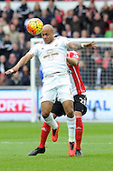 Swansea's Andre Ayew  is challenged by Southampton's Ryan Bertrand. Barclays Premier league match, Swansea city v Southampton at the Liberty Stadium in Swansea, South Wales on Saturday 13th February 2016.<br /> pic by  Carl Robertson, Andrew Orchard sports photography.