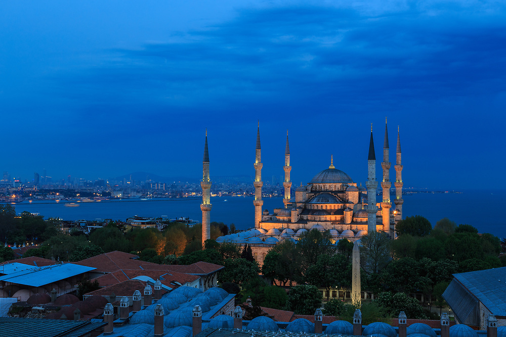 Sultan Ahmed Mosque in Istanbul, Turkey. It is also known as the Blue Mosque because of its bluish interior decoration. It is the most famous mosque of Istanbul standing in Sultanahmet area.  The Ottoman sultan Ahmed I built it between 1609 - 1616 with the help of some of the same stonemasons who later constructed the Taj Mahal in India.
