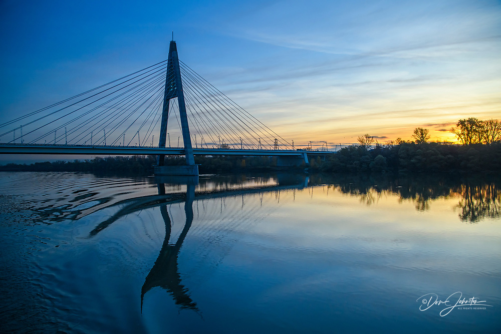 Approaching Budapest on the Danube River at dawn- suspension bridge, Budapest, Central Hungary, Hungary