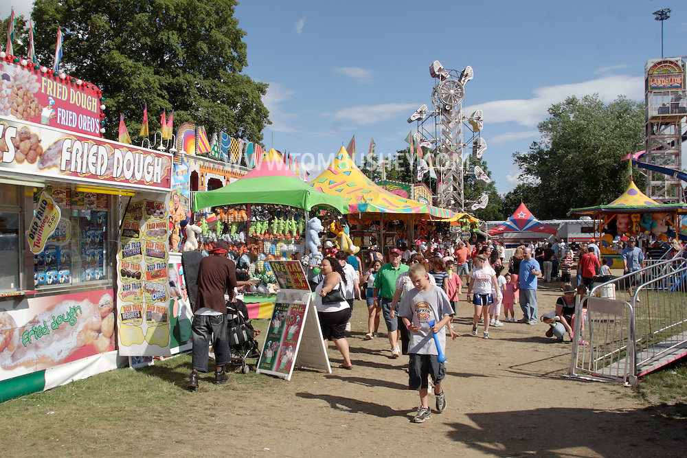 New Paltz, NY - People walk past food vendors and carnival games at the Ulster County Fair on Aug. 3, 2008.
