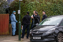 © Licensed to London News Pictures. 06/01/2020. London, UK. Police forensics teams and police at a house in Nowell Road, Barnes South West London after police discovered human remains at the address on Friday 3rd January 2020. A 17 year old youth has now been charged with murder following the discovery at the address in Nowell Road. Photo credit: Alex Lentati/LNP