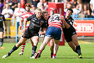 Takes three Bradford Bulls players to stop Oldhams Michael Ward during the Kingstone Press Championship match between Oldham RLFC and Bradford Bulls at Bower Fold, Oldham, United Kingdom on 13 August 2017. Photo by Simon Davies.