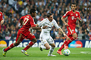 Champions League semi final second leg soccer match between Real Madrid and FC Bayern Munich at the Santiago Bernabeu stadium in Spain - <br /> MADRID 25/04/2012<br /> ESTADIO SANTIAGO BERNABEU.<br /> half final, Halbfinale, Semifinale,  CHAMPIONS LEAGUE<br /> REAL MADRID 2 - BAYERN 1<br /> picture: DI MARIA. BOATENG.- fee liable image, copyright © ATP QUEEN INTERNACIONAL<br /> <br /> Real MADRID vs Fc BAYERN Match 2:1 und 3:1 im Elfmeterschieflen - and 3:1 in penalty shooting - Queen photographer Fernando ALVAREZ