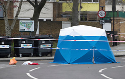 © Licensed to London News Pictures. 02/04/2019. London, UK. A police evidence tent is seen on the road in Kentish Town, north London, where a man in his 20s was found with fatal stab wounds at 8.30 pm on 1st April.  Another man has been stabbed in Edmonton this morning. Photo credit: Peter Macdiarmid/LNP