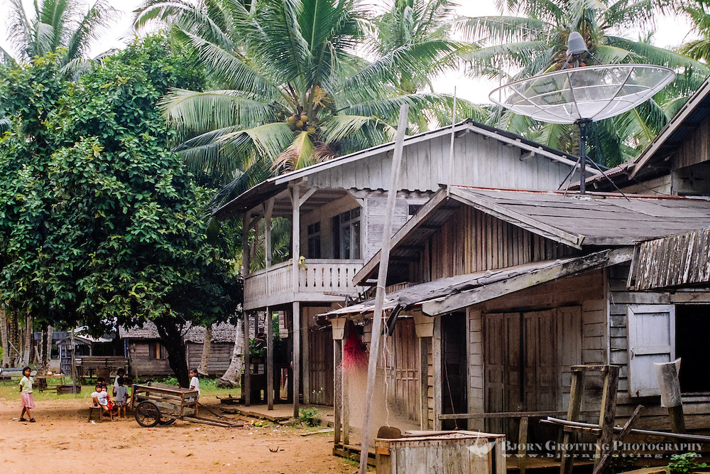 Kalimantan, Tanjung Datu. Small village close to the Malaysian border. Even here, far from nearest civilization, a television satellite dish is found on top of a roof.