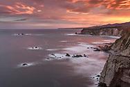 Sunrise with intense red sky over the rocky coast, Asturias, Spain<br /> <br /> Sonnenaufgang mit intensivem Morgenrot über der Felsküste, Asturien, Spanien