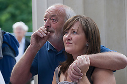 © licensed to London News Pictures. London, UK 30/06/2012. Peter Attreed and Deanne Attreed crying as they remember loss of a family member in March 1945. Bomber Command Memorial in Green Park was made in the name of 55,573 Bomber Command airmen who gave their lives in the Second World. The memorial was opened by the Queen earlier this week. Photo credit: Tolga Akmen/LNP