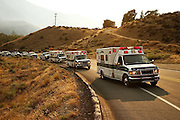 Ambulances carrying the bodies of three fallen firefighters travel out of Twisp to Omak, Washington during a procession Thursday, Aug. 20, 2015.<br /> <br /> Erika Schultz / The Seattle Times