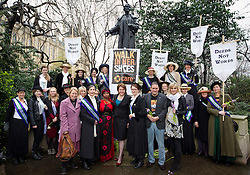 © Licensed to London News Pictures. 08/03/2013. London, UK. Maria Miller, Minister for Women and Equalities (centre below sign) is seen with women dressed as suffragettes below a statue of Emily Pankhurst after walking to Parliament on International Women's Day in London today (08/03/2013). The end of the walk, which coincides with International Women's Day, launches poverty charity Care International's 'Walk in Her Shoes Campaign', which encourages women to put themselves the shoes of women in the developing world. Photo credit: Matt Cetti-Roberts/LNP