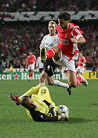 Photo: Lee Earle.<br /> Benfica v Liverpool. UEFA Champions League. 2nd Round, 1st Leg. 21/02/2006. Liverpool keeper Jose Reina (L) saves from Simao.