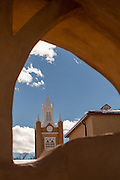Steeple of the San Felipe de Neri Church historic adobe style Catholic church in the Old Town Plaza December 14, 2015 in Albuquerque, New Mexico.