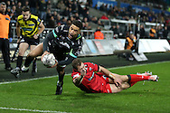 Keelan Giles of the Ospreys runs in and scores his try in the 2nd half. Guinness Pro12 rugby match, Ospreys v Edinburgh Rugby at the Liberty Stadium in Swansea, South Wales on Friday 2nd December 2016.<br /> pic by Andrew Orchard, Andrew Orchard sports photography.