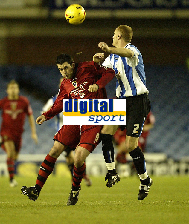 Photo: Aidan Ellis.<br /> Sheffield Wednesday v Cardiff City. Coca Cola Championship. 25/11/2006.<br /> Cardiff's Steven Thompson cant get past Wednesday's Lee Bullen