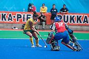 Marsha Cox of South Africa takes on Italy's Sara Sorial in the penalty shoot out during their match in the Investec Hockey World League Semi Final 2013, Quintin Hogg Memorial Sports Ground, University of Westminster, London, UK on 29 June 2013. Photo: Simon Parker