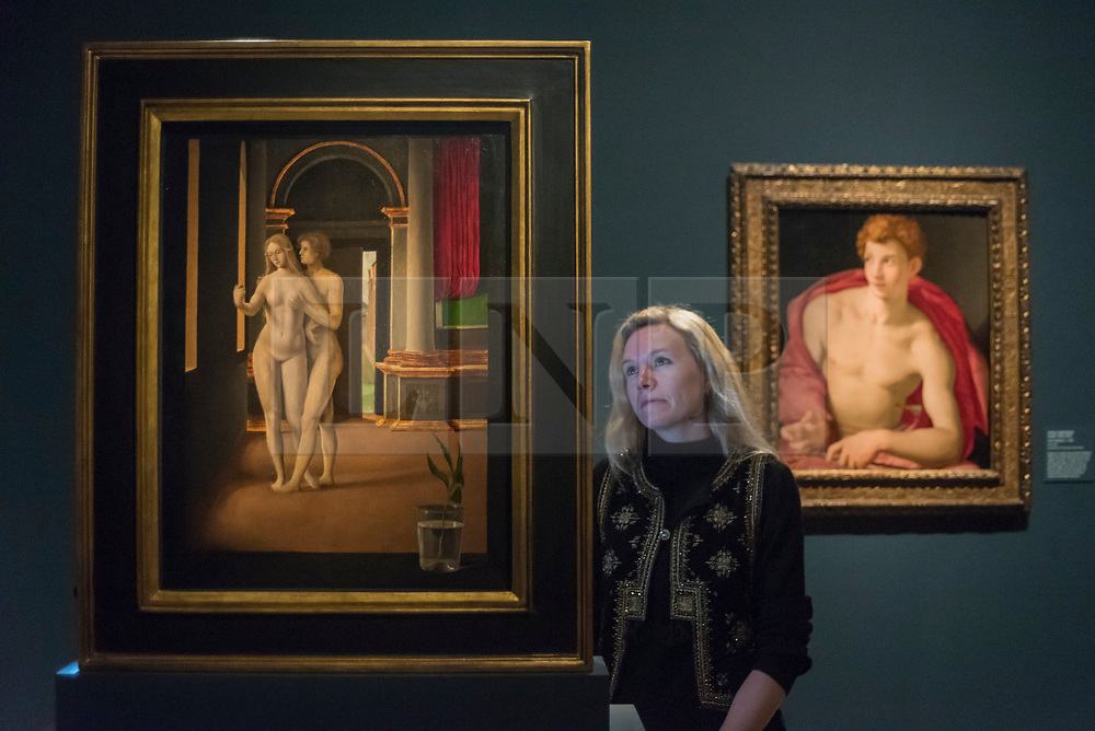 """© Licensed to London News Pictures. 28/02/2019. LONDON, UK. A staff member views (L to R) """"Lover in an Interior"""" before 1497 by Jacometto Veneziano or close follower and """"Saint Sebastian"""" c1533 by Agnolo Bronzino. Preview of """"The Renaissance Nude"""", an exhibition at the Royal Academy of Arts in Piccadilly of 90 works examining the emergence of the nude in European art.  Works by artists including Leonardo da Vinci to Michelangelo are on display in the Sackler Galleries 3 March to 2 June 2019.  Photo credit: Stephen Chung/LNP"""