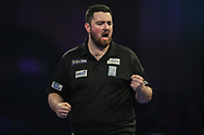 Luke Humphries wins the first set in his third round match against Dimitri Van den Bergh and celebrates during the World Darts Championships 2018 at Alexandra Palace, London, United Kingdom on 27 December 2018.