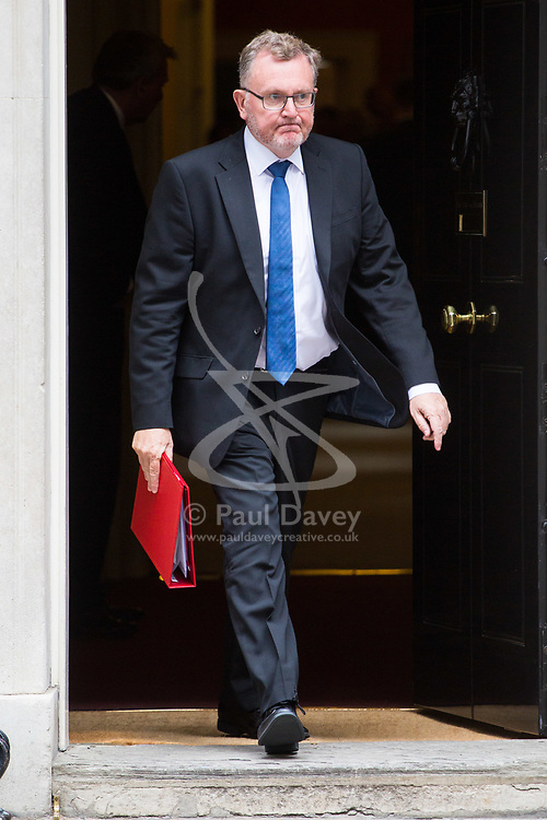 London, July 4th 2017. Scotland Secretary David Mundell leaves the weekly cabinet meeting at 10 Downing Street in London.