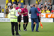 Sheffield Wednesday manager Carlos Carvalhal discusses the game with the match officials including referee Darren Bond during the EFL Sky Bet Championship match between Burton Albion and Sheffield Wednesday at the Pirelli Stadium, Burton upon Trent, England on 26 August 2017. Photo by Richard Holmes.