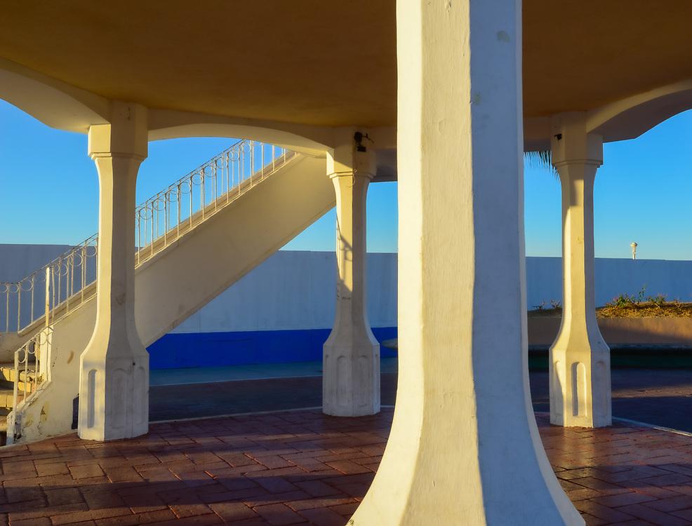 Viewing platform support columns along the Malecon, evening light, February, La Paz, Baja, Mexico