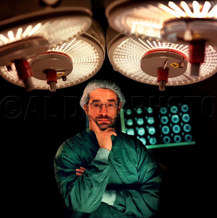 12/15/96 Al Diaz/Herald Staff--John Ragheb, M.D. with the University of Miami School of Medicine, in his scrubs at the Hospitals surgery room. The doctor performed surgery on patient Judy McCollum, 9. Judy was shot in the head one day before was to start school.