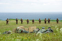 Members of the Northern World War Two Association. Portraying 8th company 2nd Battalion GrossDeutschland Division German Army lie in wait for the advancing elements of 5th Battalion East Yorkshires, 50th Division,  during a large scale Western Front  battle reenactment. .Scarborough.Sunday 30th May 2010 .Images © Paul David Drabble.