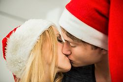 Young couple romancing on Christmas eve, Munich, Bavaria, Germany