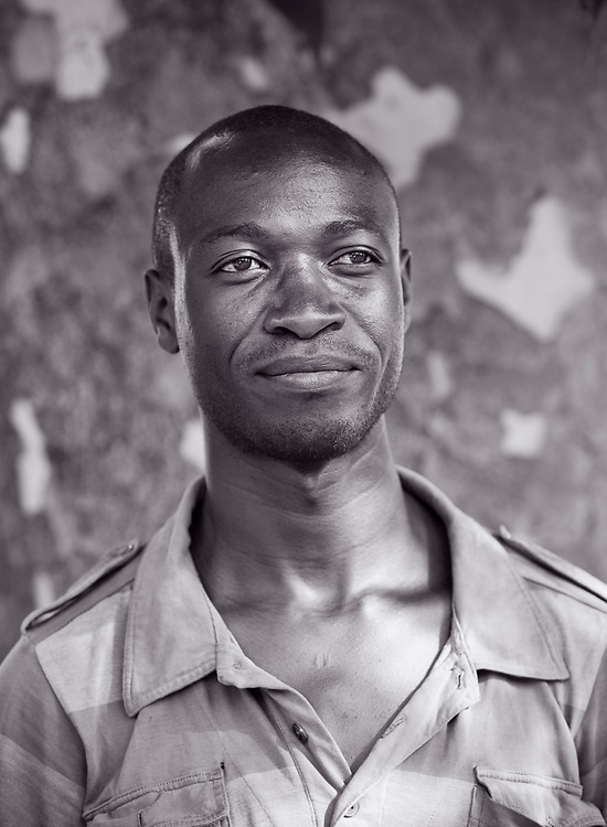 David Makala, a Zambian artist, photographed under a large tree in Lusaka, Zambia.