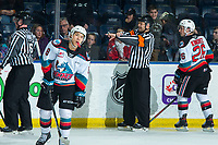KELOWNA, BC - JANUARY 4: Referee Chris Crich makes a holding call against the Vancouver Giants at the Kelowna Rockets at the Kelowna Rockets at Prospera Place on January 4, 2020 in Kelowna, Canada. (Photo by Marissa Baecker/Shoot the Breeze)