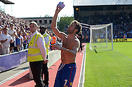 Yohan Cabaye of Crystal Palace throws his match day shirt to the Palace supporters after the final whistle. Barclays Premier league match, Crystal Palace v Aston Villa at Selhurst Park in London on Saturday 22nd August 2015.<br /> pic by John Patrick Fletcher, Andrew Orchard sports photography.