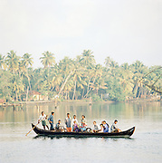 A group of local people cross the Kerala Backwaters, Kerala, India.