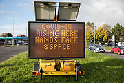 A sign warns visitors to the town of rising numbers of local cases of the coronavirus and of the need to follow the Government's Hand Face And Space message on 23 October 2020 in Slough, United Kingdom. The Government has announced that Slough will change its COVID Alert Level status from Tier 1 Medium Alert to Tier 2 High Alert with effect from 00:01 on Saturday 24 October following a sustained rise in COVID-19 cases resulting in an infection rate of 153 cases per 100,000.