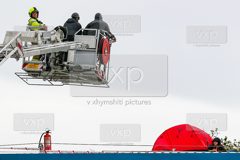 """Leicester, United Kingdom, May 20, 2021: UK based Pro-Palestinian activists group """"Palestine Action"""" who seized control of the Leicester based factory of Elbit subsidiary UAV Tactical Systems on Wednesday, continue to occupy its rooftop for the 2nd day with activists saying that """"the occupation is aiming to be as disruptive as possible; these activists are determined to prevent Elbit from resuming its business of bloodshed."""" (Photo by Vudi Xhymshiti/VXP)"""