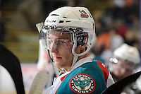 KELOWNA, CANADA, FEBRUARY 11: Cody Chikie #14 of the Kelowna Rockets stands on the bench as the Kamloops Blazers visit the Kelowna Rockets on February 11, 2012 at Prospera Place in Kelowna, British Columbia, Canada (Photo by Marissa Baecker/Shoot the Breeze) *** Local Caption ***