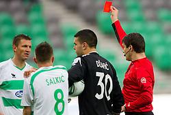 David Kasnik of Olimpija receiving red card from referee Matej Jug during football match between NK Olimpija Ljubljana and NK Luka Koper of 29th Round of PrvaLiga, on April 7, 2012, in SRC Stozice, Ljubljana, Slovenia.  (Photo by Vid Ponikvar / Sportida.com)