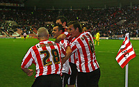 Photo: Andrew Unwin.<br />Sunderland v Southampton. Coca Cola Championship. 11/11/2006.<br />Sunderland's Ross Wallace (C) is mobbed by his team-mates as they celebrate his goal.
