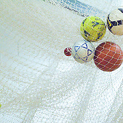 Close-up of a soccer balls in soccer goal post