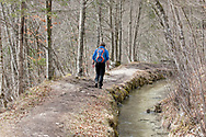 Hiking to the Mostnica Gorge beside an old water channel connected to the area's former industrial/mining heritage. Bohinj, Slovenia © Rudolf Abraham