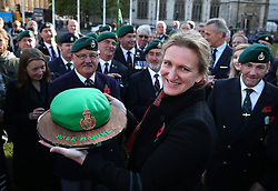 © Licensed to London News Pictures. 28/10/2015. London, UK. Claire Blackman (C) receives a cake shaped as a Royal Marines beret in Parliament Square during a rally calling for her husband, Sgt Alexander Blackman to be released.  Sgt Blackman was sentence for killing a Talliban insurgent in Afghanistan in 2011. He was convicted of murder at a court martial in 2013.   Photo credit: Peter Macdiarmid/LNP
