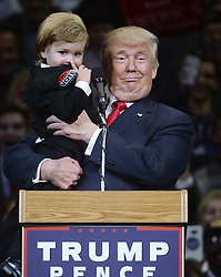 Republican presidential nominee Donald J. Trump holds a baby boy while campaigning at the Mohegan Sun Arena in Wilkes-Barre, PA, USA, on Monday October 10, 2016. Photo by Dennis Van Tine/ABACAPRESS.COM  | 566544_014 Wilkes-Barre, Etats-Unis United States