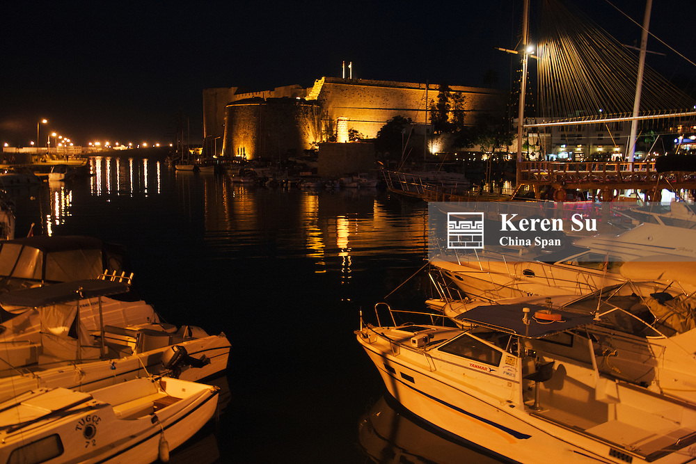 Night view of historic harbor and castle at sunset, Kyrenia, Turkish Republic of Northern Cyprus