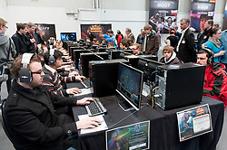 Visitors playing computer games at CeBIT 2011 digital and electronics trade fair in Hannover March 2011 Germany