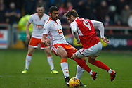 Wes Burns of Fleetwood Town is fouled by Blackpool's Colin Daniel  during the EFL Sky Bet League 1 match between Fleetwood Town and Blackpool at the Highbury Stadium, Fleetwood, England on 25 November 2017. Photo by Paul Thompson.