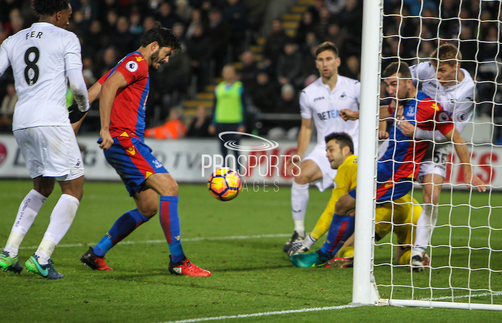 James Tomkins of Crystal Palace scores his teams second goal during the Premier League match between Swansea City and Crystal Palace at the Liberty Stadium, Swansea, Wales on 26 November 2016. Photo by Andrew Lewis.