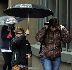 © Licensed to London News Pictures. 11/10/2013<br /> Tourists getting wet.<br /> Wet rainy weather today (11.10.2013)  City Of London,EC3 <br /> Photo credit :Grant Falvey/LNP