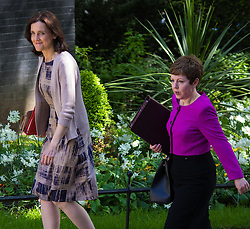 Downing Street, London, May 12th 2015. The all-conservatives Cabinet ministers gather for their first official meeting at Downing Street. PICTURED: Northern Ireland Secretary Theresa Villiers (left) arrives at Number 10 with Leader of the House of Lords Baroness Stowell