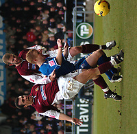 Photo: Ian Hebden.<br />Northampton Town v Rushden & Diamonds. Coca Cola League 2. 04/02/2006.<br />Northampton's Scott McGleish (L) and Rushden's Ronnie Bull (R) clash for the ball.