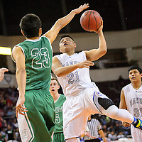 031314  Adron Gardner/Independent<br /> <br /> Laguna Acoma Hawk Deion Natseway (21) moves to the left hand on a field goal attempt against the Texico Wolverines during the state high school basketball tournament at the Santa Ana Star Center in Rio Rancho Thursday.