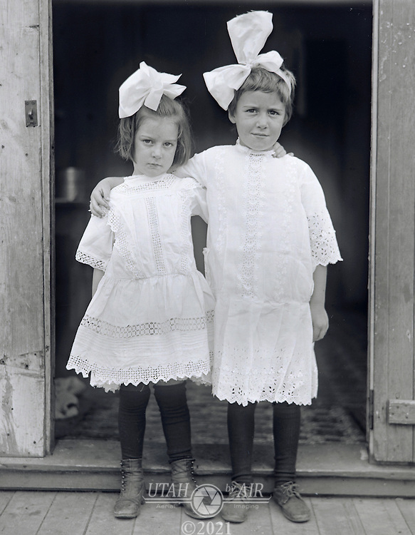 little girls dressed in white early 1900's