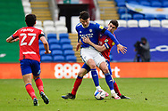 Darragh Lenihan (26) of Blackburn Rovers battles for possession with Kieffer Moore (10) of Cardiff City during the EFL Sky Bet Championship match between Cardiff City and Blackburn Rovers at the Cardiff City Stadium, Cardiff, Wales on 10 April 2021.